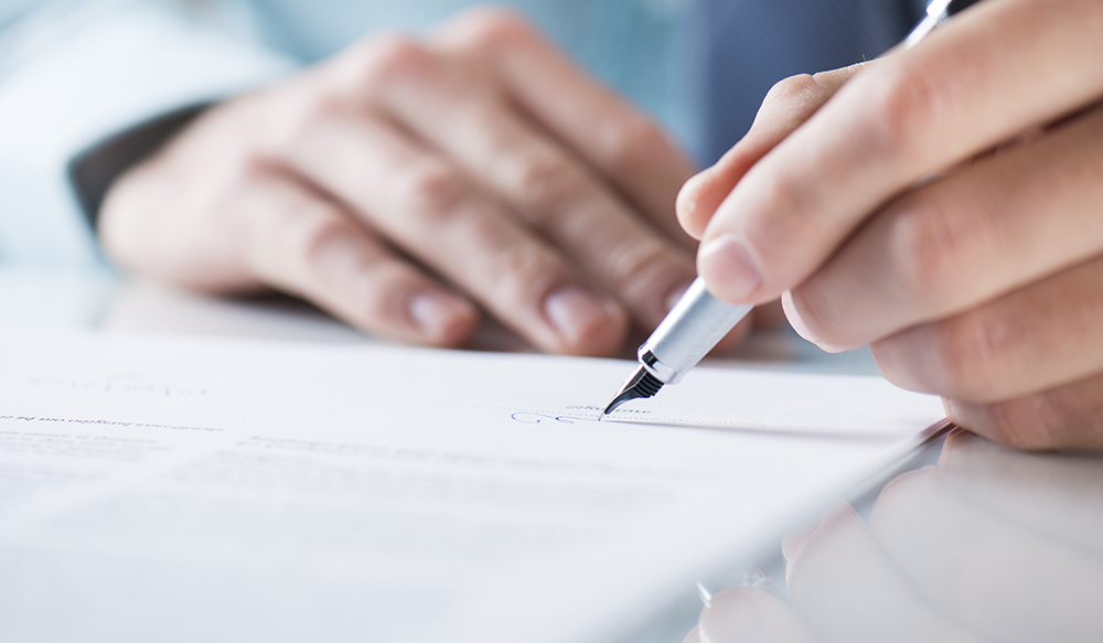 Home owner is signing a contract