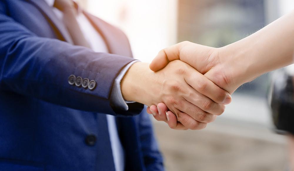 Close up at handshake property negotiation